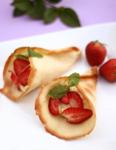 tuiles cones stuffed with cream and strawberries