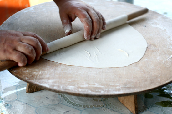 Rolling out the dough for Azerbaijani filled flatbread